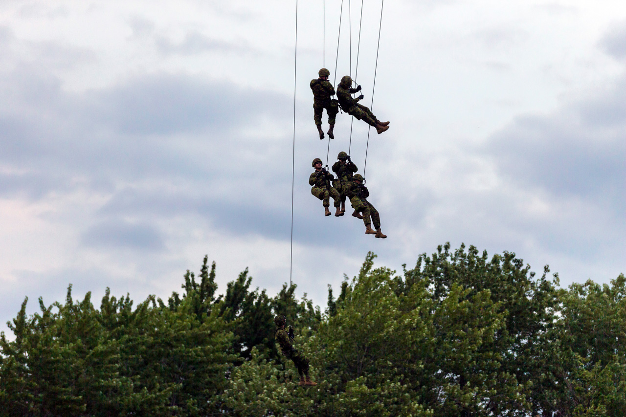 Canadian infantry rappelling from Royal Canadian Air Force Helicopter.