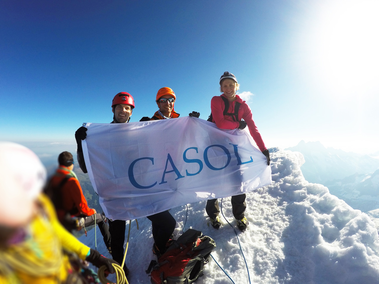 Antoine Labranche, Guillaume Omont and Alina Zagaytova, holding the CASOL flag at the summit of the Eiger